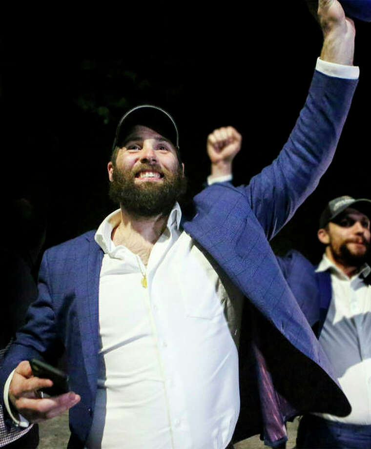 Patrick Maroon greets fans after arriving at the airport in St. Louis after winning the Stanley Cup Final. Photo: AP Photo