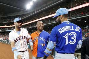 Lordes Gurriel Sr. wears a dueling jersey for both his sons Houston Astros first baseman Yuli Gurriel (10), and Toronto Blue Jays left fielder Lourdes Gurriel Jr. (13) before the start of the first inning of an MLB baseball game at Minute Maid Park, Sunday, June 16, 2019.  Gurriel Sr. was preparing to throw out the first pitch with other Astros fathers.