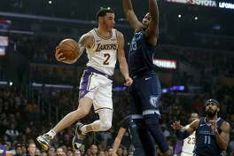 Los Angeles Lakers guard Lonzo Ball (2) attempts a pass while guarded by Memphis Grizzlies forward Jaren Jackson Jr. (13) on December 23, 2018, at Staples Center in Los Angeles. (Gary Coronado/Los Angeles Times/TNS)