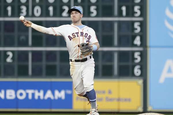 Houston Astros Alex Bregman (2) makes the throw to first as Toronto Blue Jays Rowdy Tellez ground out during the eighth inning of an MLB baseball game at Minute Maid Park, Sunday, June 16, 2019.