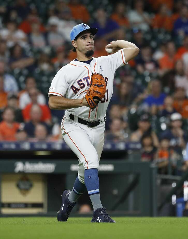 Houston Astros relief pitcher Cionel Perez (51) fields Toronto Blue Jays Lourdes Gurriel Jr.'s ground ball during the eighth inning of an MLB baseball game at Minute Maid Park, Sunday, June 16, 2019. Photo: Karen Warren/Staff Photographer