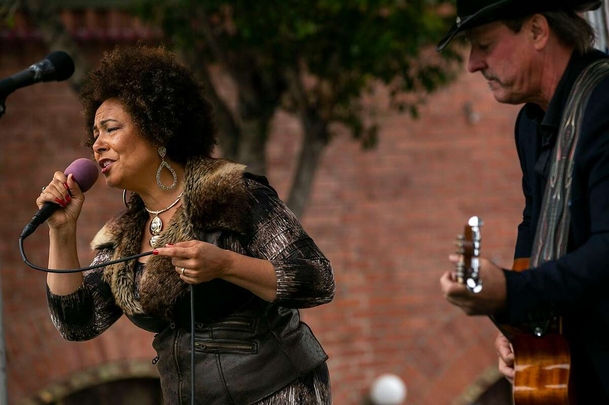 Jeff Jolly and Desiree perform at the 65th annual North Beach Festival on Sunday, June 16, 2019, in San Fransisco, Calif.