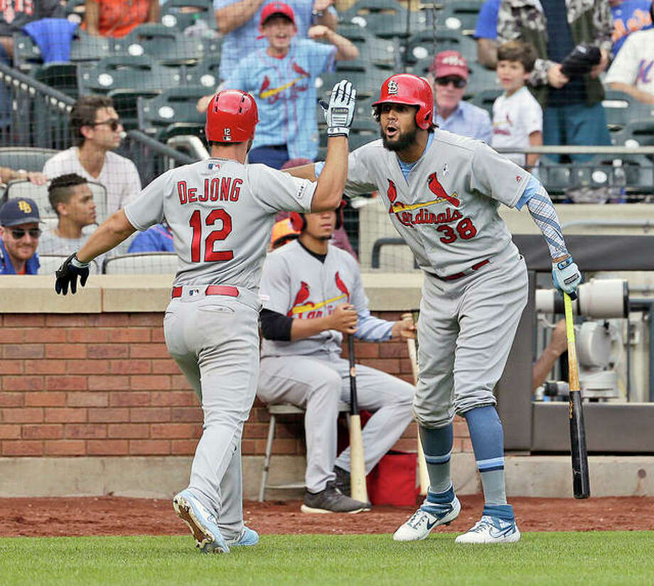 The Cardinals' Jose Martinez, right, celebrates teammate Paul DeJong's solo home run in the eighth inning Sunday's 4-3 victory over the New York Mets in New York. Photo: AP Photo