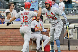The Cardinals' Jose Martinez, right, celebrates teammate Paul DeJong's solo home run in the eighth inning Sunday's 4-3 victory over the New York Mets in New York.