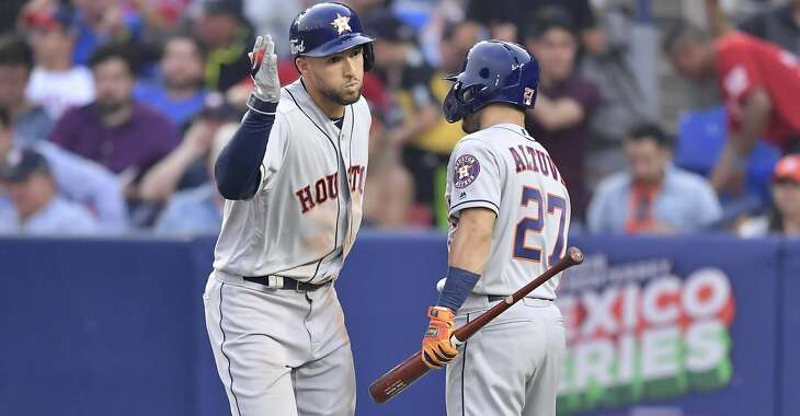MONTERREY, MEXICO - MAY 04: George Springer, #4 of the Houston Astros, celebrates with teammate Jose Altuve, #27, after hitting a home run on the sixth inning of the Houston Astros vs Los Angeles Angels of Anaheim match at Estadio de Beisbol Monterrey on May 04, 2019 in Monterrey, Nuevo Leon. (Photo by Azael Rodriguez/Getty Images)
