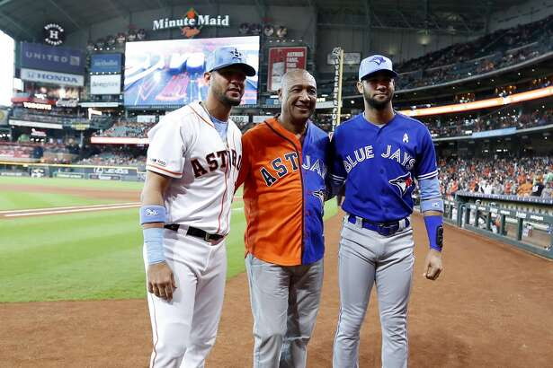 Lourdes Gurriel Sr. wears a dueling jersey for both his sons Houston Astros first baseman Yuli Gurriel (10), and Toronto Blue Jays left fielder Lourdes Gurriel Jr. (13) before the start of the first inning of an MLB baseball game at Minute Maid Park, Sunday, June 16, 2019. Gurriel Sr. was preparing to throw out the first pitch with other Astros fathers.