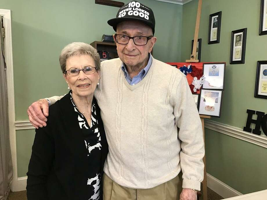Mark Gredinger of Woodbridge turned 100 Sunday and says his wife, Marilyn, standing next to him, is one of the secrets to his longevity. Photo: Photo By Pam McLoughlin / Photo By Pam McLoughlin