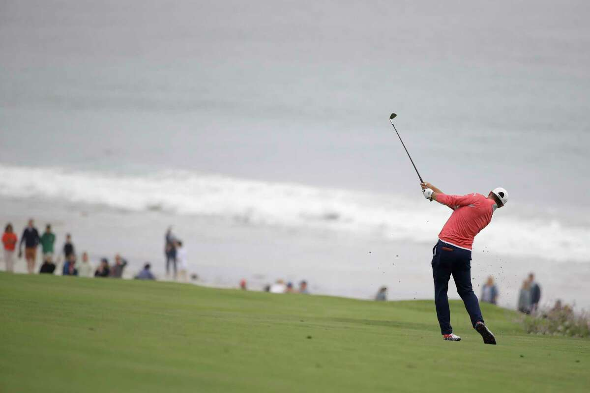 Gary Woodland hits from the fairway on the 10th hole during the final round of the U.S. Open Championship golf tournament Sunday, June 16, 2019, in Pebble Beach, Calif.