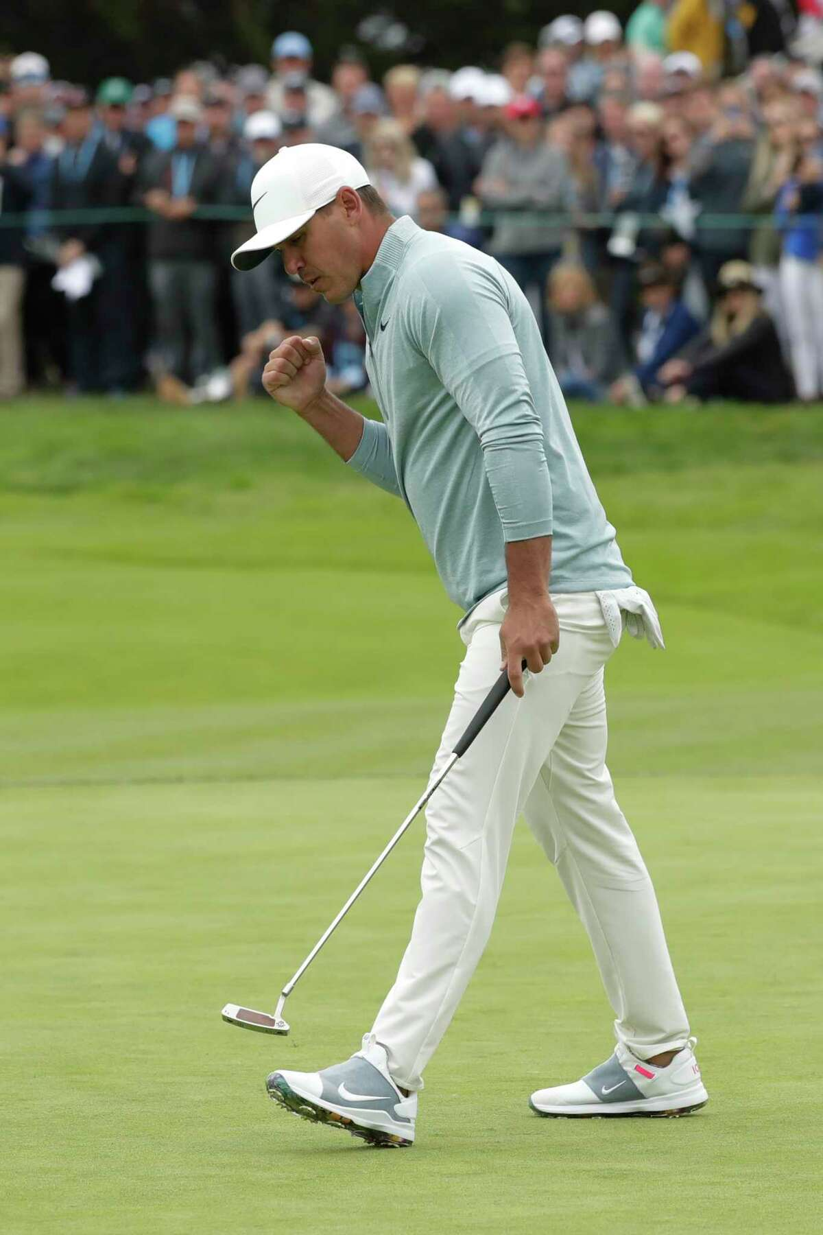 Brooks Koepka reacts after making a putt on the 11th hole during the final round of the U.S. Open Championship golf tournament Sunday, June 16, 2019, in Pebble Beach, Calif.