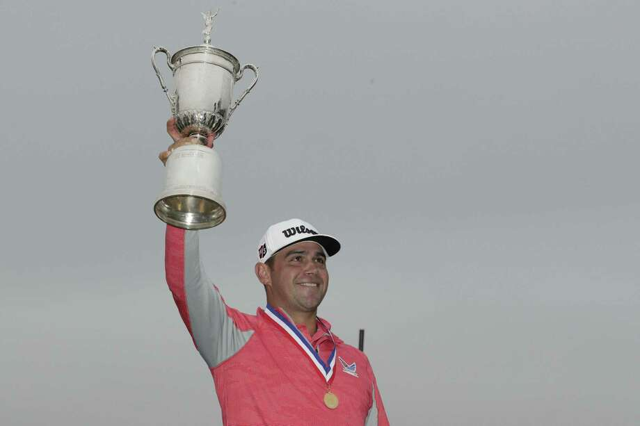 Gary Woodland celebrates with the trophy after winning the U.S. Open Championship golf tournament Sunday, June 16, 2019, in Pebble Beach, Calif. Photo: Matt York, STF / Associated Press / Copyright 2019 The Associated Press. All rights reserved.