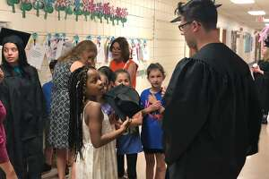 Mohegan School students got to chat with some graduating seniors, who were returning to their old elementary school in their graduation garb.