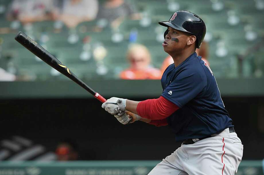 Boston Red Sox's Rafael Devers follows through on a solo home run against the Baltimore Orioles in the 10th inning of a baseball game Sunday, June 16, 2019, in Baltimore. (AP Photo/Gail Burton) Photo: Gail Burton / Copyright 2019 The Associated Press. All rights reserved