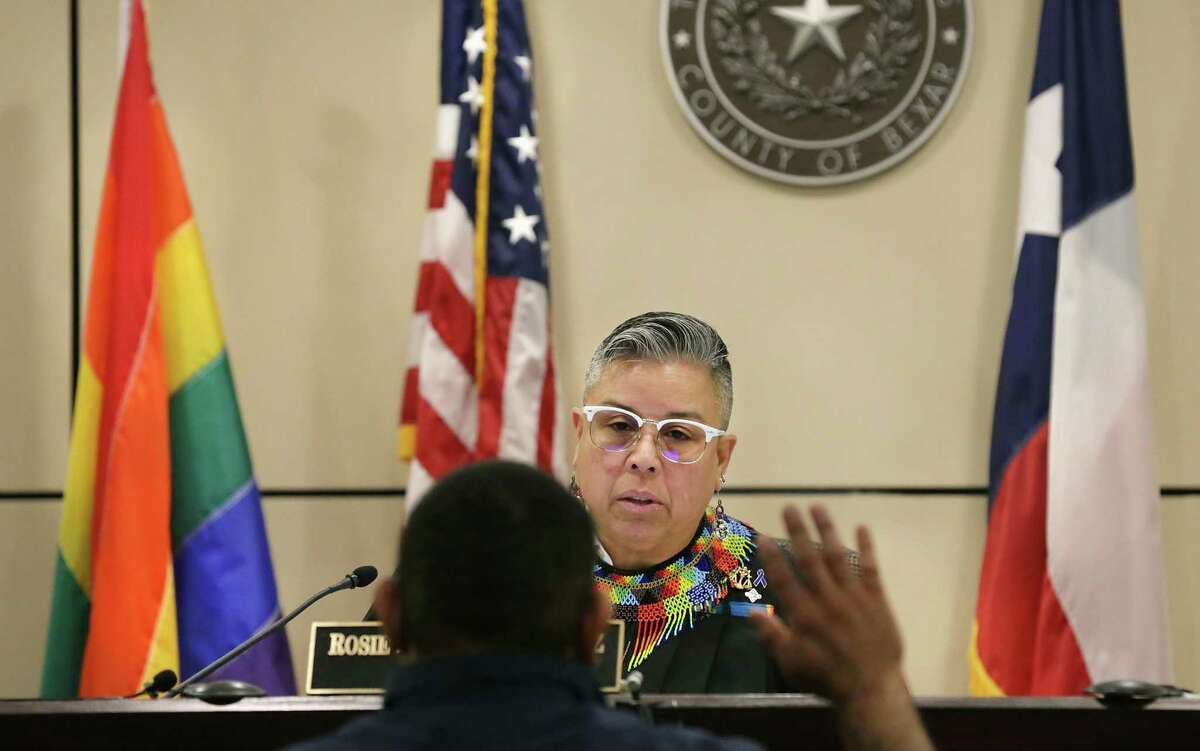 Bexar County Judge Rosie Speedlin Gonzalez hears cases in the Cadena-Reeves Justice Center in 2019. Why is the display of a rainbow flag different from the symbols displayed by judges in other courtrooms?