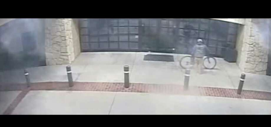 A man was observed riding a bicycle to the front entrance of the church. He then entered the church by crawling through a window. The suspect appears to be an adult Hispanic male. At the time of the incident, he was wearing a camouflage ball cap, gray hooded sweatshirt, khaki-colored pants and boots. Photo: Midland Crime Stoppers