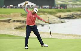 Gary Woodland begins his celebration after sinking a birdie putt on No. 18 to complete his championship run in the U.S. Open at Pebble Beach.