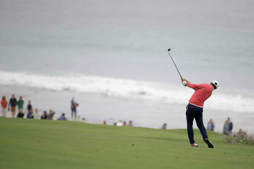 Gary Woodland hits from the fairway on the 10th hole during the final round of the U.S. Open Championship golf tournament Sunday, June 16, 2019, in Pebble Beach, Calif. (AP Photo/Marcio Jose Sanchez)