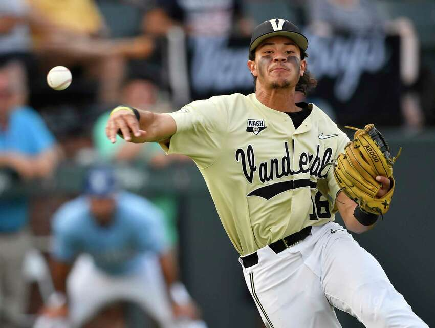 Vanderbilt third baseman Austin Martin makes a throw to first base for the out on an Indiana State batter during the second inning of an NCAA college baseball tournament regional game Saturday, June 1, 2019, in Nashville, Tenn. (George Walker IV/The Tennessean via AP)