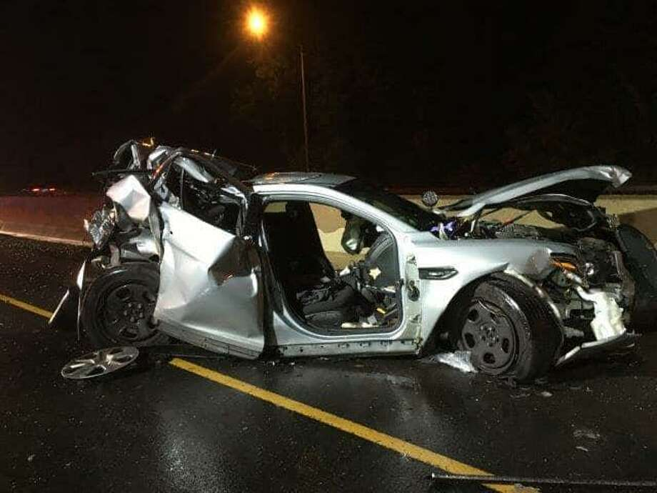 A state police trooper was seriously injured early Sunday, June 16, 2019 while three others suffered minor injuries after a car crashed into a parked cruiser in Fairfield. The trooper had stopped to help a car that was broken down on the median of Interstate 95 when a third vehicle veered into the left shoulder and struck the cruiser, state police said. Photo: State Police Photo