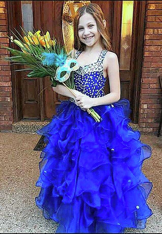 Doctors at the Cincinnati Children's Hospital have been treating Calla Woods, 9, for aggressive, rare brain tumors. Photo: Photo Provided