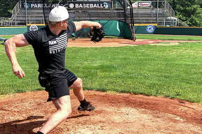 Anthony Silkwood delivers a pitch during a post-Tommy John surgery rehab session last week at Parkland Community College in Champaign. Silkwood's pitches reached a speed of 92 mph during the session. The Marquette Catholic High grad and Marine Corps veteran has signed to play baseball at Western Carolina University.