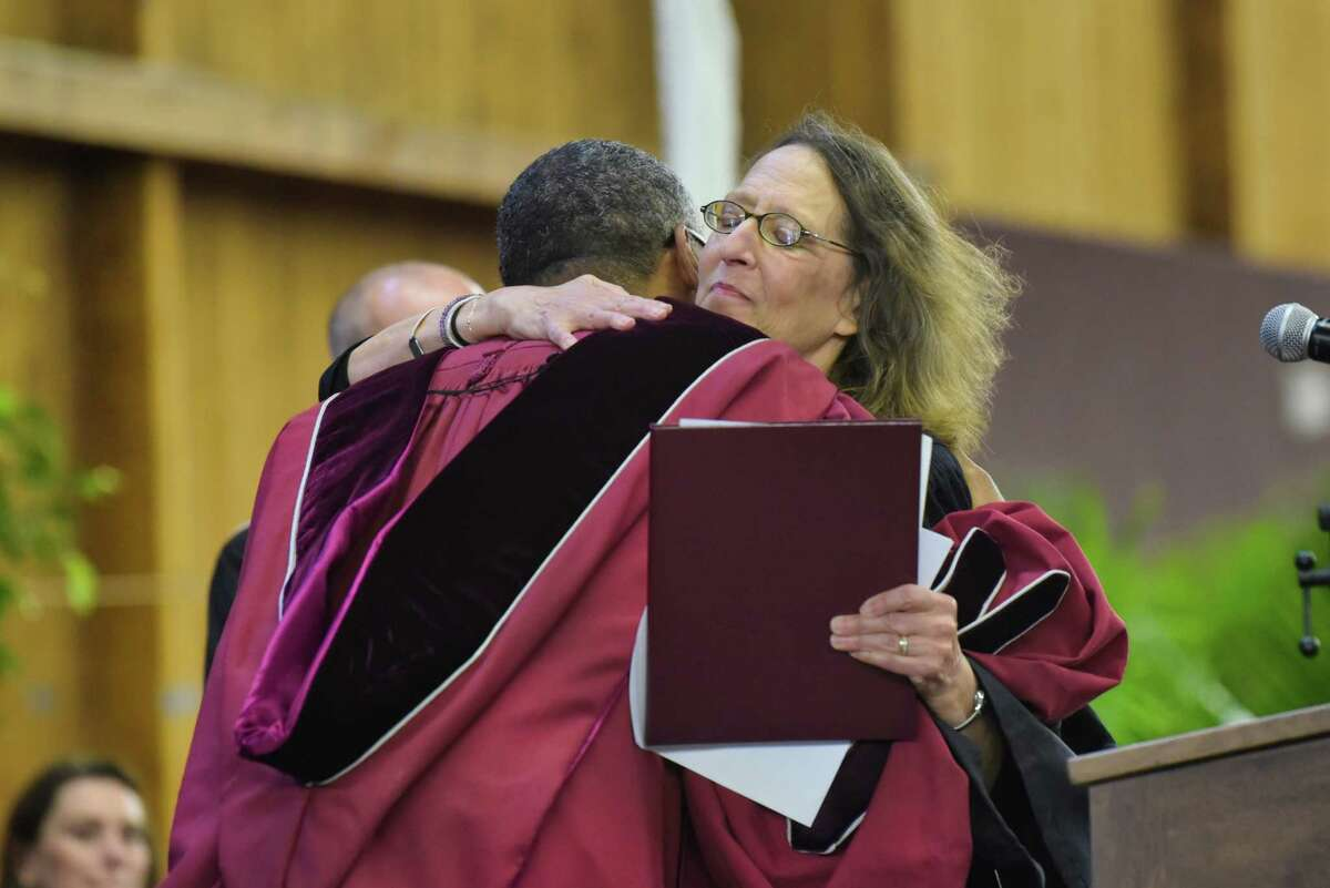 Union College President David Harris hugs Deborah Margolin, founding member of Split Britches Theater Company and a professor of practice in Yale University's Theater Studies Program at the Union College Commencement on Sunday, June 16, 2019, in Schenectady, N.Y. Margolin was awarded an honorary doctorate of letters degree. Nearly 500 students received their degrees on Sunday. (Paul Buckowski/Times Union)