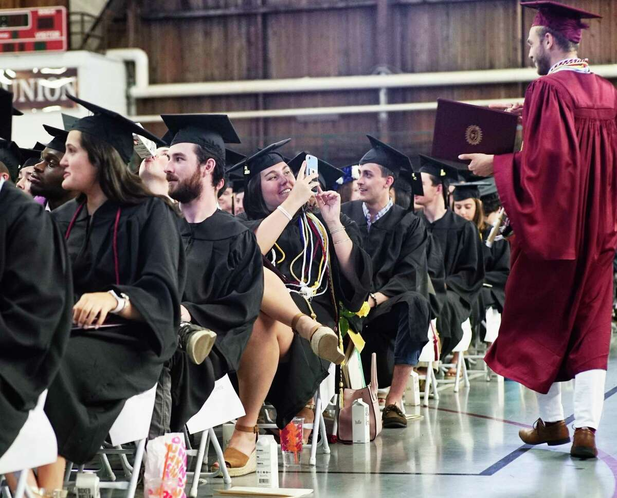 Casey Moriarty, left, takes a photo of a fellow graduate at the Union College Commencement on Sunday, June 16, 2019, in Schenectady, N.Y. Nearly 500 students received their degrees on Sunday. (Paul Buckowski/Times Union)