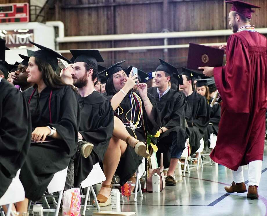 Casey Moriarty, left, takes a photo of a fellow graduate at the Union College Commencement on Sunday, June 16, 2019, in Schenectady, N.Y. Nearly 500 students received their degrees on Sunday.   (Paul Buckowski/Times Union) Photo: Paul Buckowski / (Paul Buckowski/Times Union)