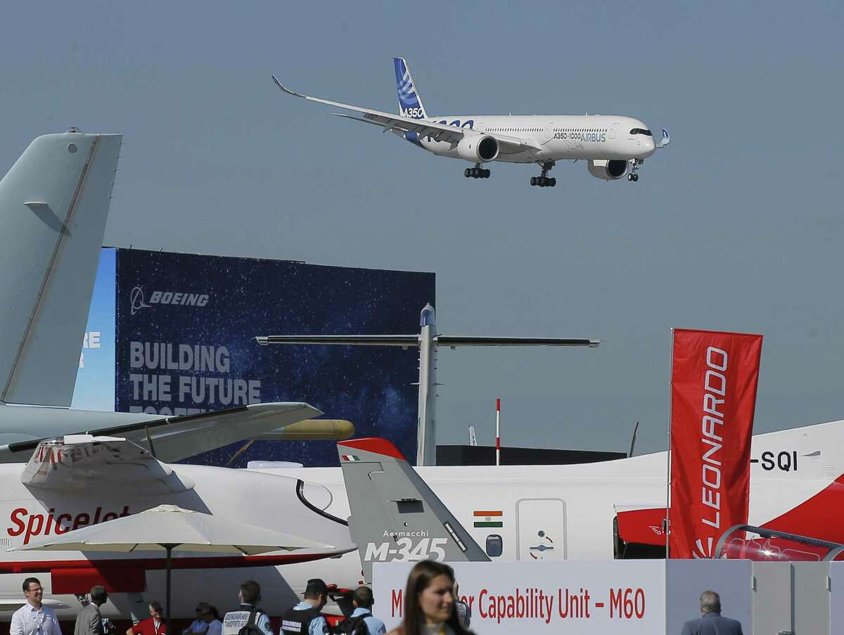 An Airbus A 350 performs his demonstration flight at Paris Air Show, in Le Bourget, east of Paris, France, Monday, June 17, 2019. The world's aviation elite are gathering at the Paris Air Show with safety concerns on many minds after two crashes of the popular Boeing 737 Max. (AP Photo/Michel Euler)
