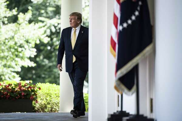 President Trump arrives to deliver remarks on expanding health coverage options for small businesses and workers in the Rose Garden at the White House on Friday.