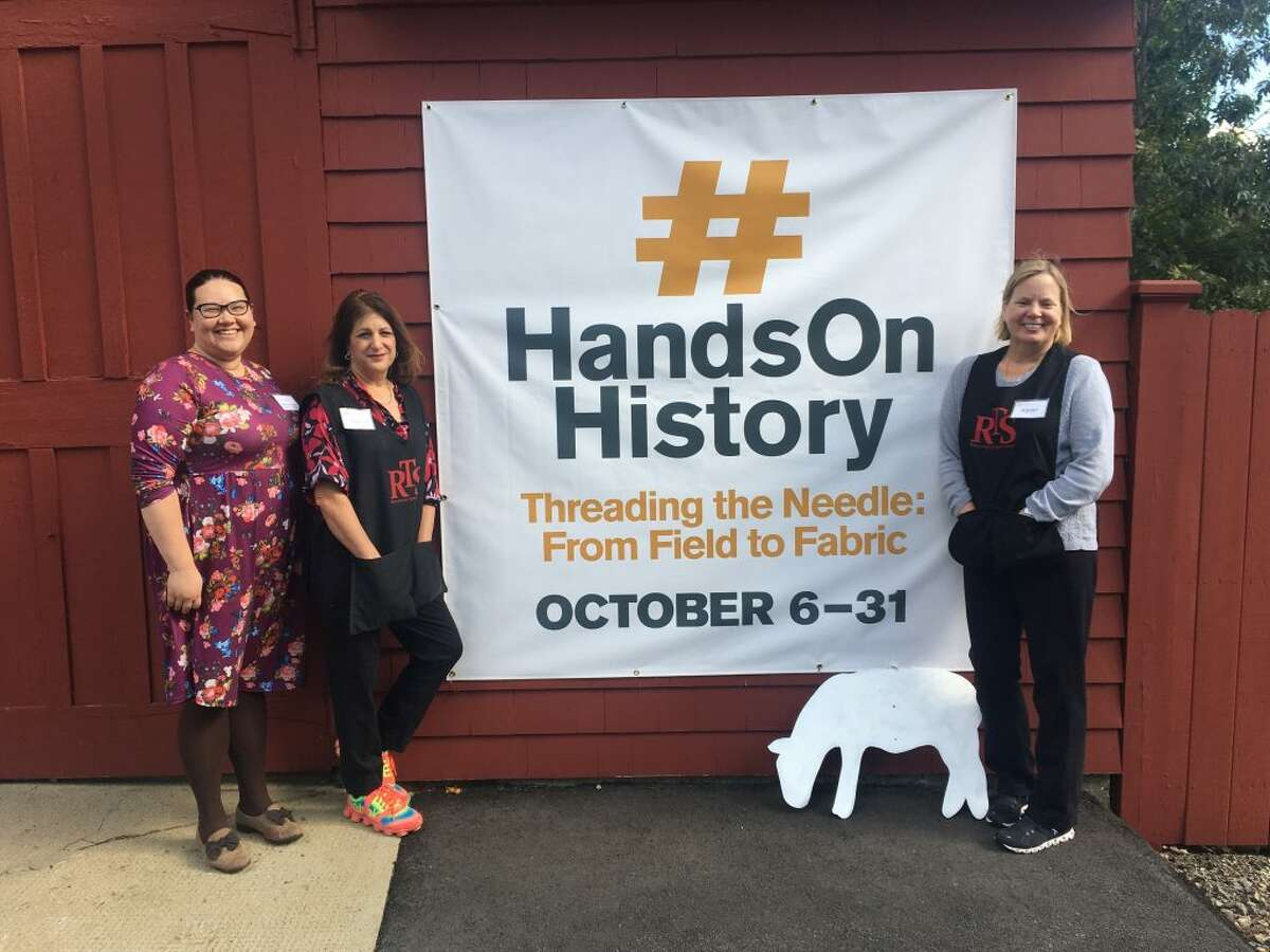 From left to right, Catherine Prescott, KTM&HC assistant museum director; Sandra Capriotti, Ridgefield Thrift Shop president and Karen Petrazzini, Thrift Shop store manager, in front of the historic Cass Gilbert Carriage Barn.