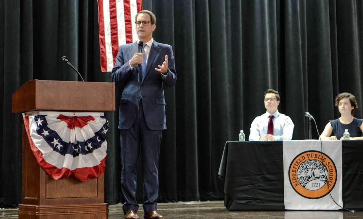 Congressman Jim Himes (D) speaks as Ridgefield High School students Josh Burn and Sophia Haber listen during the annual candidates debate Tuesday, Oct. 23. Himes' challengers, Harry Arora (R), also participated in the debate.