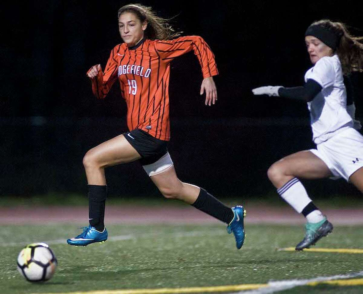Carrina Dabroi beats a Trumbull player to the ball during Thursday night's FCIAC quarterfinal game. - Scott Mullin photo
