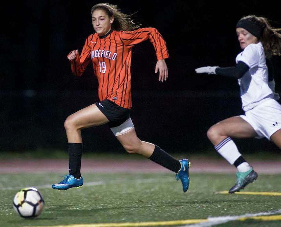 Carrina Dabroi beats a Trumbull player to the ball during Thursday night's FCIAC quarterfinal game. — Scott Mullin photo / Scott Mullin ownership