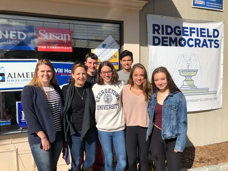 Pictured, from left to right: Michaela Fitzgerald, RHS; Aimee Berger-Girvalo, candidate for state representative; Rose Cioffi, Ossining High School; Ben Brewster, RHS; Ramiro Davila, RHS; Katherine Smalley, recent graduate of Binghamton University, and Emma Langis, RHS. Missing from the photo are: Ridgefield High School students Jack Sjoberg and Sam Sulzinsky who have both been serving on Berger-Girvalo's campaign.