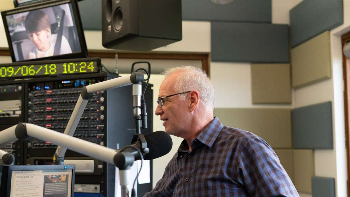 Scott Schulte delivers a morning broacast KZIA radio station in Cedar Rapids, Iowa earlier this year.