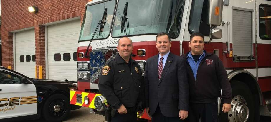 Ridgefield Police Officer Chris Daly, president of the Ridgefield Police Union, State Rep. John Frey and Ridgefield Fire Department Lt. Tony Cerulli in front of the Ridgefield Fire Department on Catoonah Street.