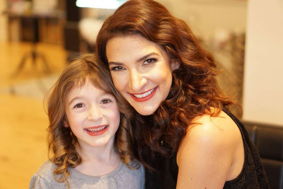 Ella with her mom Kristin McGuinness.