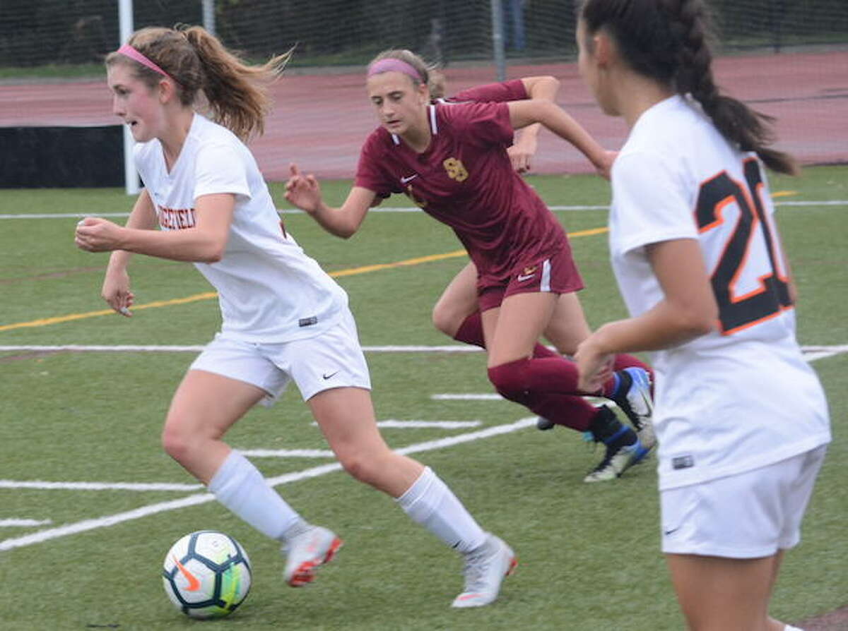 Caitlin Slaminko dribbles past a St. Joseph player during Monday's game in Trumbull. - Andy Hutchison photo