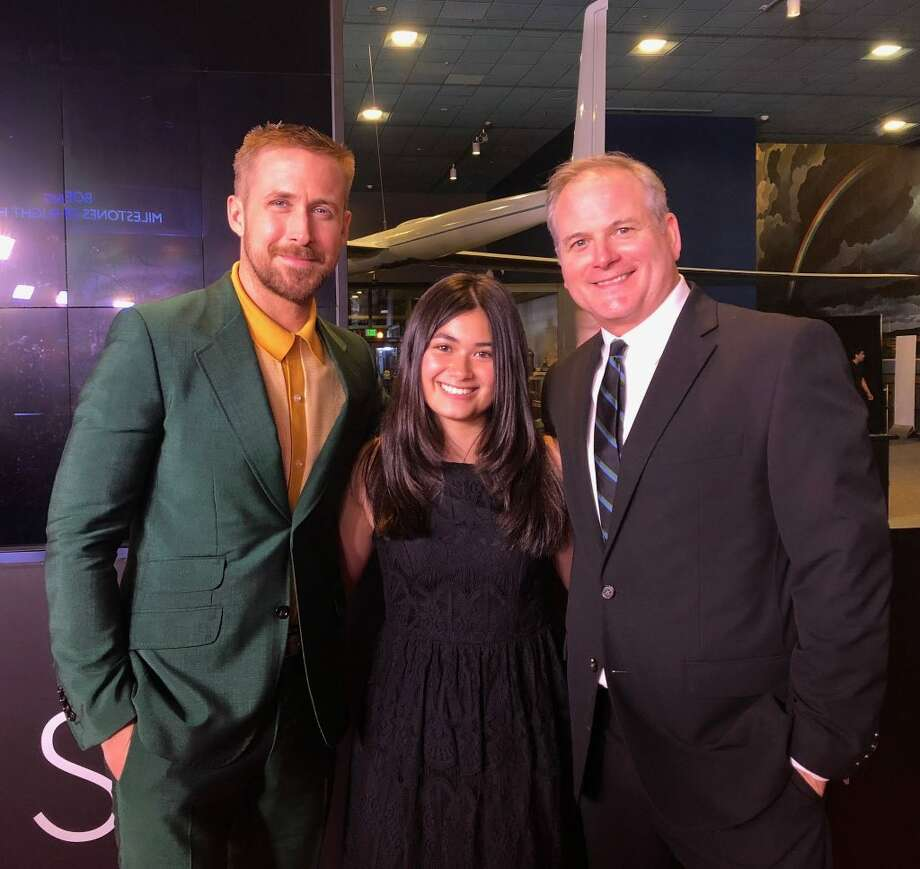 "Ridgefield resident Chris Calle, right, stands with his daughter Arianna, middle, and actor Ryan Gosling, left, at the premiere of ""First Man"" at the Air and Space Museum in Washington D.C. on Oct. 4. Calle plays his father, Paul Calle, in the movie (in theaters Friday, Oct. 12). Gosling plays astronaut Neil Armstrong. In a series of more than 40 sketches, Paul Calle captured Armstrong and his fellow Apollo 11 astronauts, Buzz Aldrin, and Michael Collins, as they prepared to launch on their historic moon landing mission on July 16, 1969. He was the only illustrator allowed in the room with them."