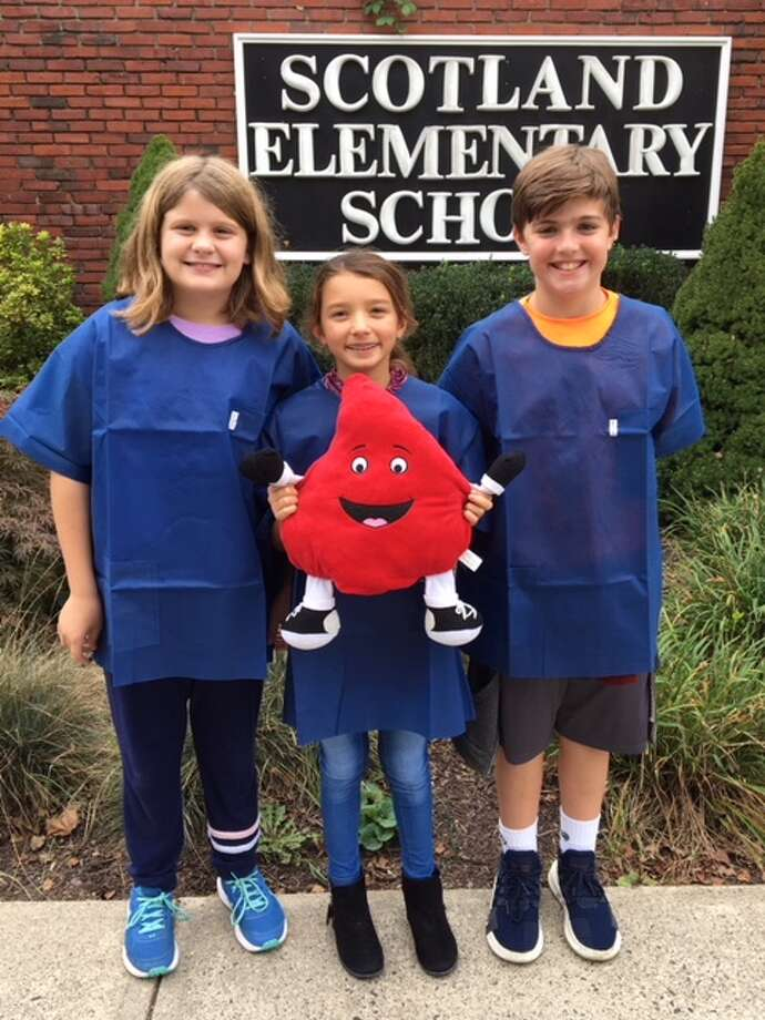 Scotland Elementary School fifth graders, from left to right, Grace Gordon, Juliette Arencibia, Daniel Petersen will be hosting the schools sixth annual blood drive Thursday, Oct. 25.