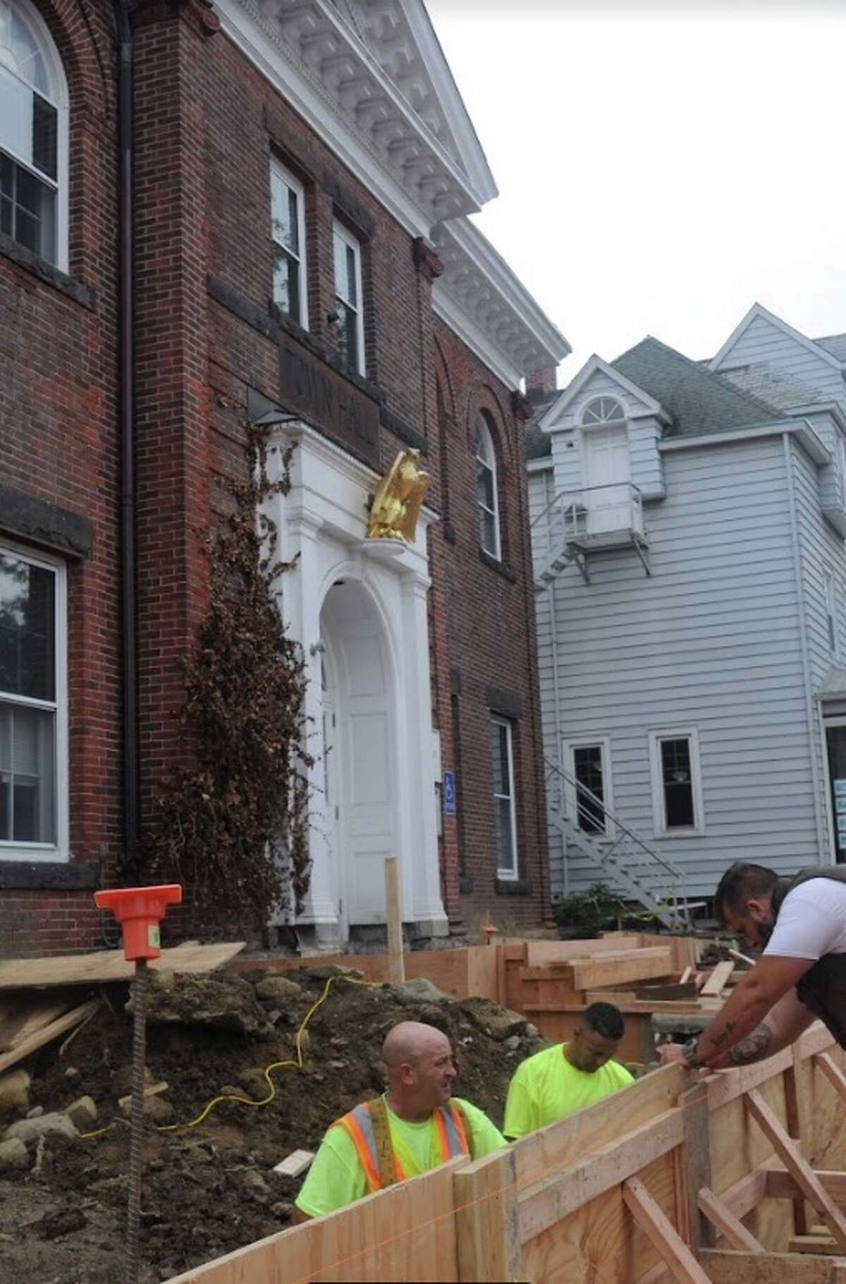 Construction work on the front of town hall is likely to go another month. People can enter off Bailey Avenue. - Macklin Reid photo