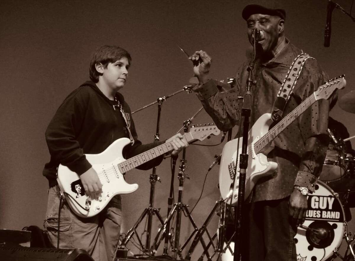 Marcky DiGiacomo was pulled on stage and got to play electric guitar with blues legend Buddy Guy on the Ridgefield Playhouse stage Sept. 25. DiGiacomo, 15, a sophomore at John Jay High School in South Salem, N.Y., plays with the School of Rock's house band in Ridgefield. - Roy Kozey photo
