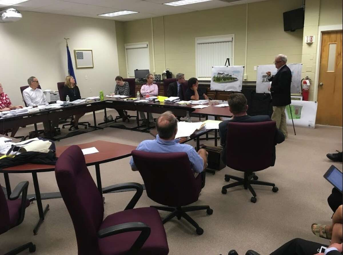 Ray Sullivan, of The Sullivan Architectural Group, presents developer Marty Handshy's plan to build a 30-unit apartment building at 233 Danbury Road to the Planning and Zoning Commission. The project would include affordable housing units under the state's 8-30g law. The town's four-year moratorium on 8-30g developments ends on Oct. 7. - Peter Yankowski photo