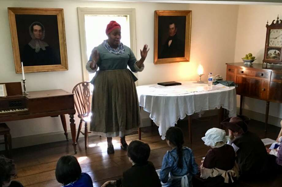 Cheyney McKnight, pictured as a historical interpreter during the Keeler Tavern Museum's #HandsOnHistory Month, will give a talk the headwraps of African women in America Sunday, Oct. 7.
