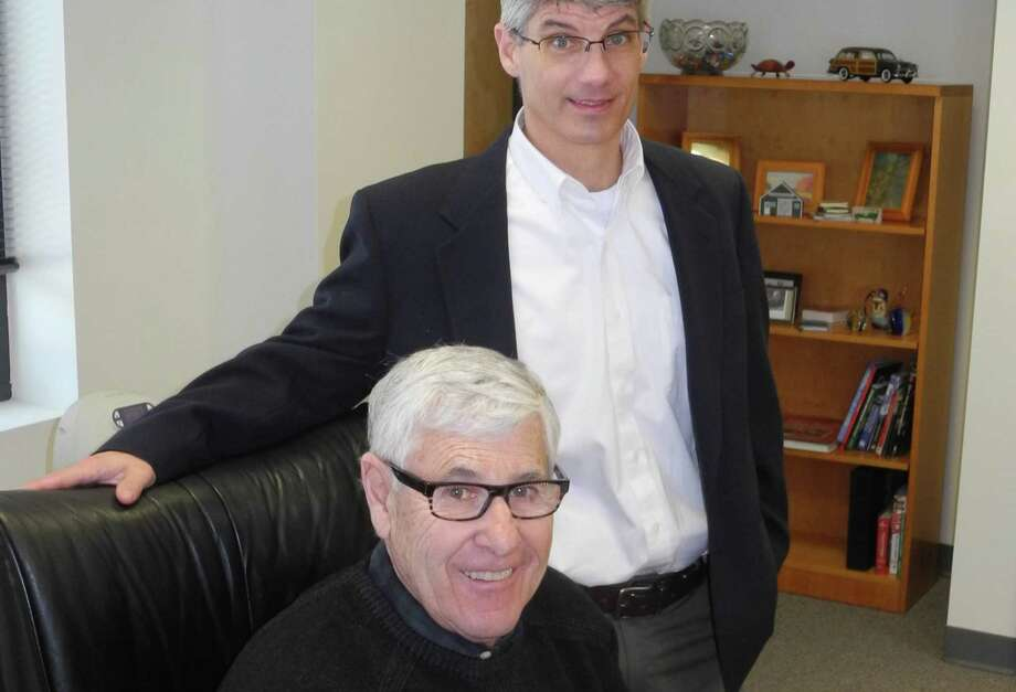 Dennis DiPinto, Ridgefield's new director of Parks and Recreation, stands behind retired Parks & Recreation Director Paul Roche earlier this year.
