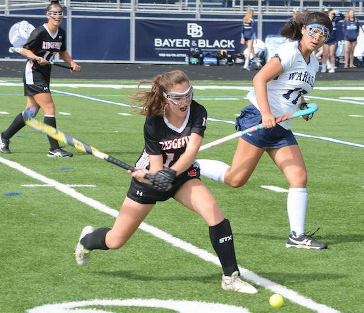 Ridgefield's Jen Paul clears the ball during a field hockey game earlier this season. The Tigers fell to New Canaan, 2-0, on Monday. - Andy Hutchison photo