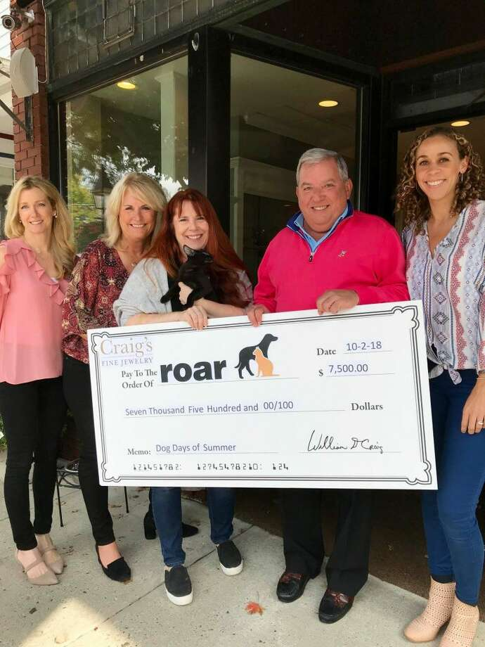 Pictured, from left to right: Deb Larson and Jen Whipple of Craig's Fine Jewelry; Kerry Dobson of ROAR and Audrey who is available for adoption; and Bill Craig and Laura Verses of Craig's Fine Jewelry.