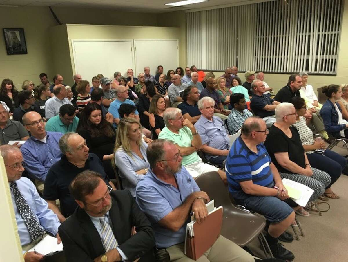 Residents crowded into the town hall annex on Wednesday, Sept. 19, for two back-to-back public hearings - one for a pond-dredging home business on Clearview Drive, and another for an affordable housing apartment building on Danbury Road. - Peter Yankowski photo