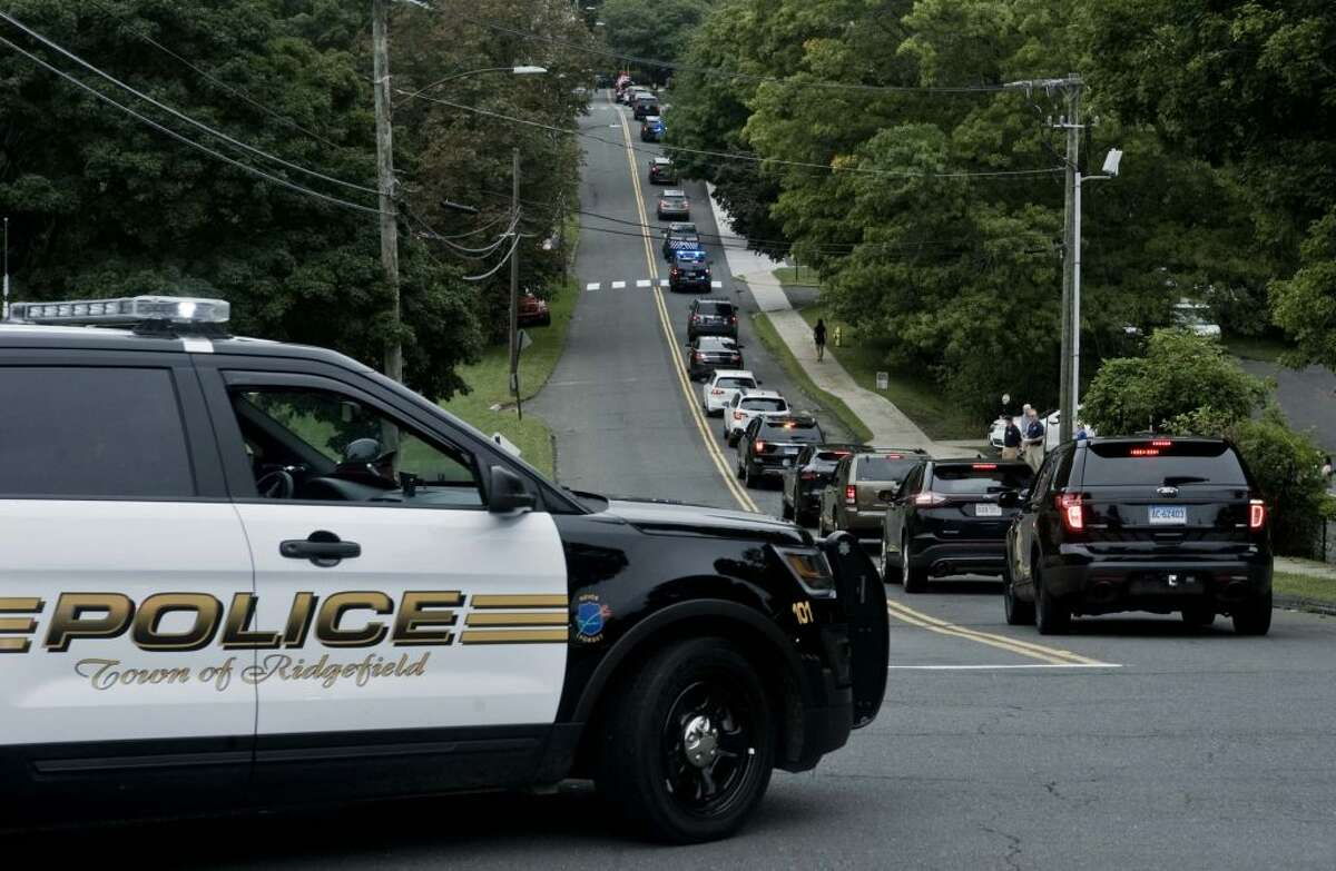 Police Chief John Roche's funeral procession drew hundreds of cops from around the state earlier this month. - Scott Mullin photo