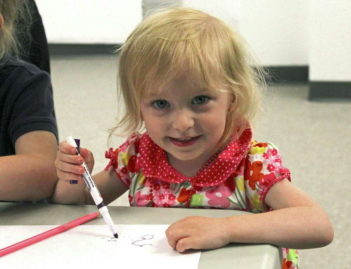 Emma Zampiello, 2, creates her own art after story time at One River School on June 15, 2019.